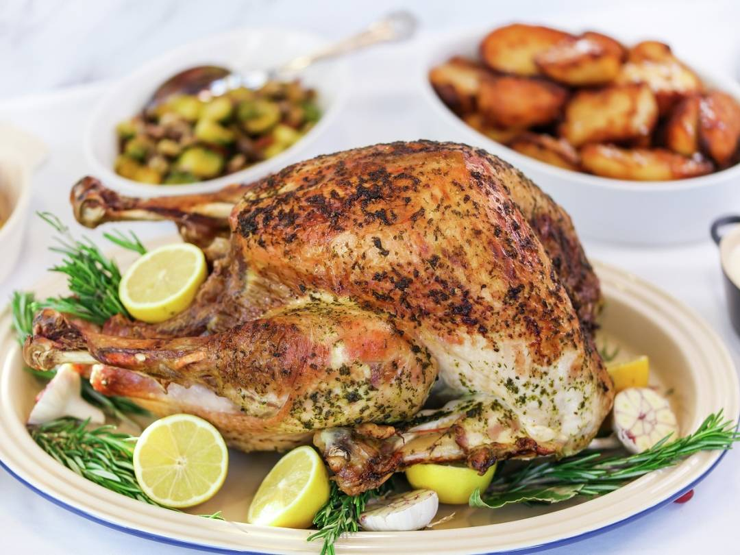 Christmas Roast turkey with lemon and herb butter landscape