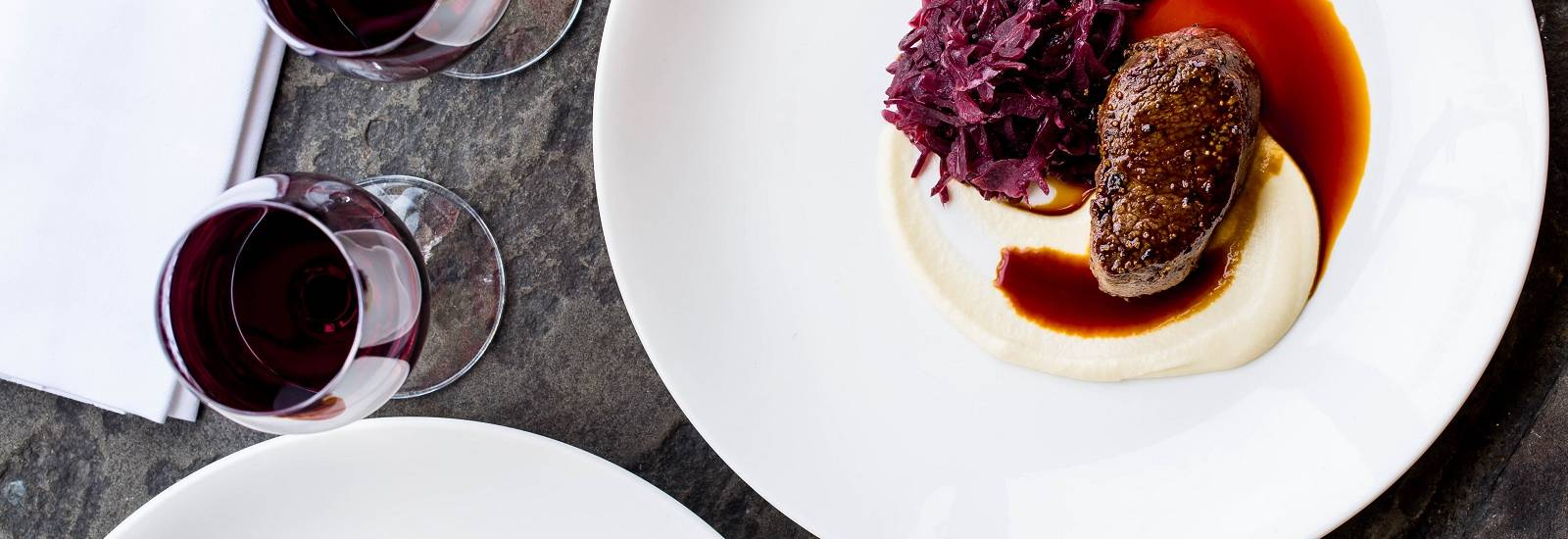 Roast saddle of venison with braised red cabbage and parsnip puree 19