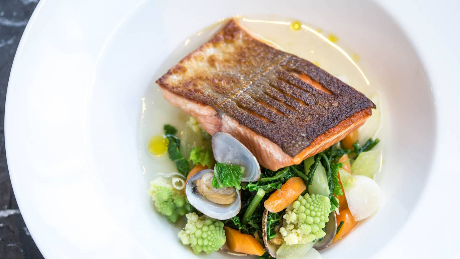 6 Roasted sea trout winter vegetables samphire palourde clams aromatic broth