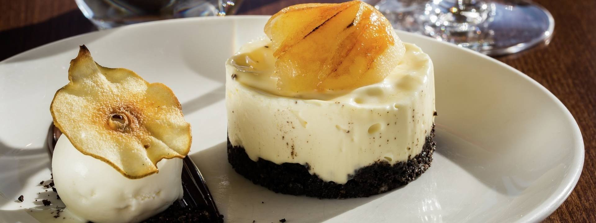 white chocolate cheesecake with vanilla poached pear